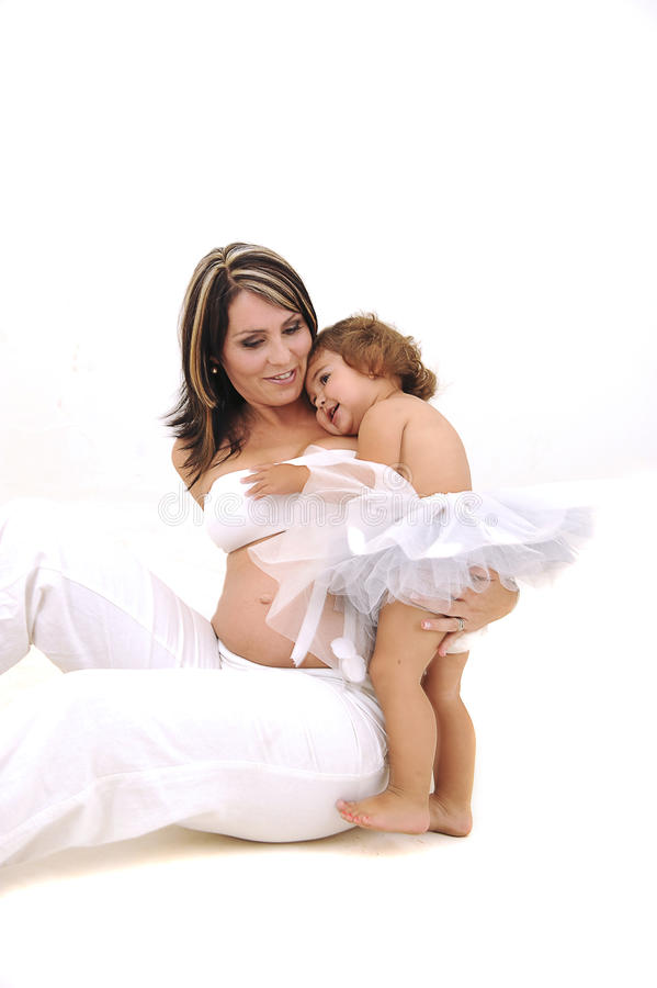 Pregnant topless mother playing with her infant stock image