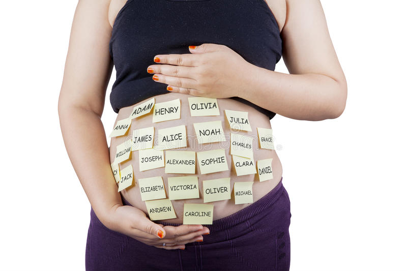 Pregnant tummy with baby names stock photo