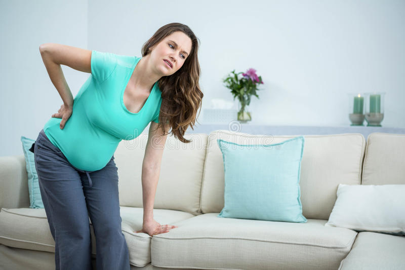 Pregnant woman with back pain royalty free stock photography