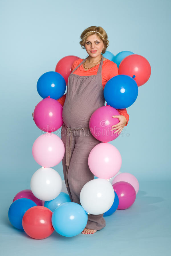 Pregnant woman with balloons. Beautiful pregnant woman with balloons stock photography