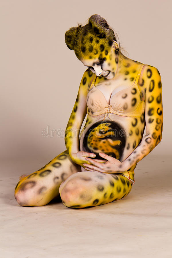 Download Pregnant Woman With Body-art As Leopard Stock Image - Image: 23351115