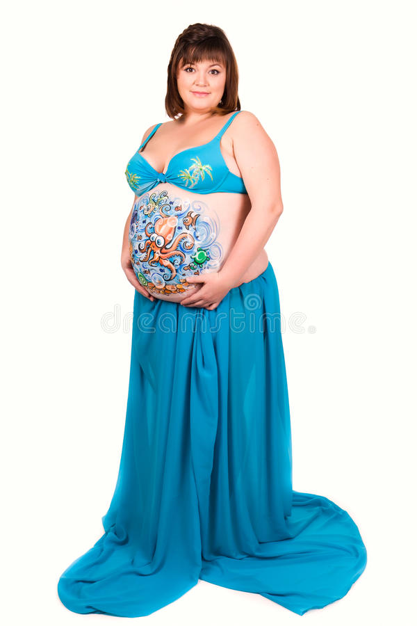 Pregnant woman with body art of sea life stock image for Fish dream meaning pregnancy