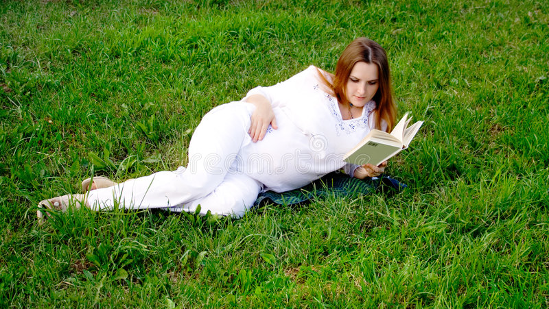 Pregnant woman with book 2 royalty free stock photo