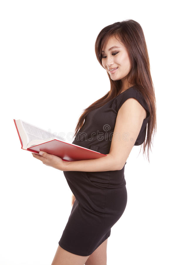 Pregnant Woman With Book Reading Royalty Free Stock Images