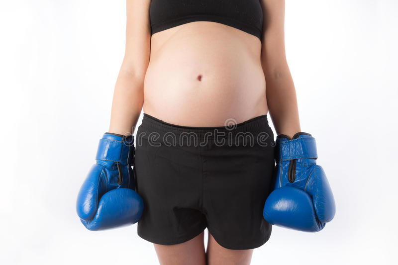 Pregnant woman in boxing gloves stock photo