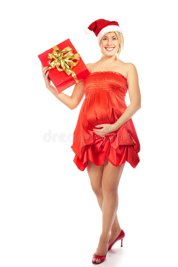 Pregnant woman caressing her belly wearing Santa Hat. Pregnant woman caressing her belly royalty free stock photos