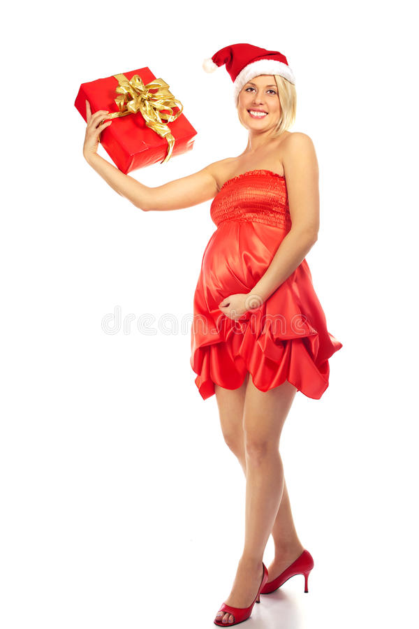 Pregnant woman caressing her belly wearing Santa Hat. Pregnant woman caressing her belly stock photo