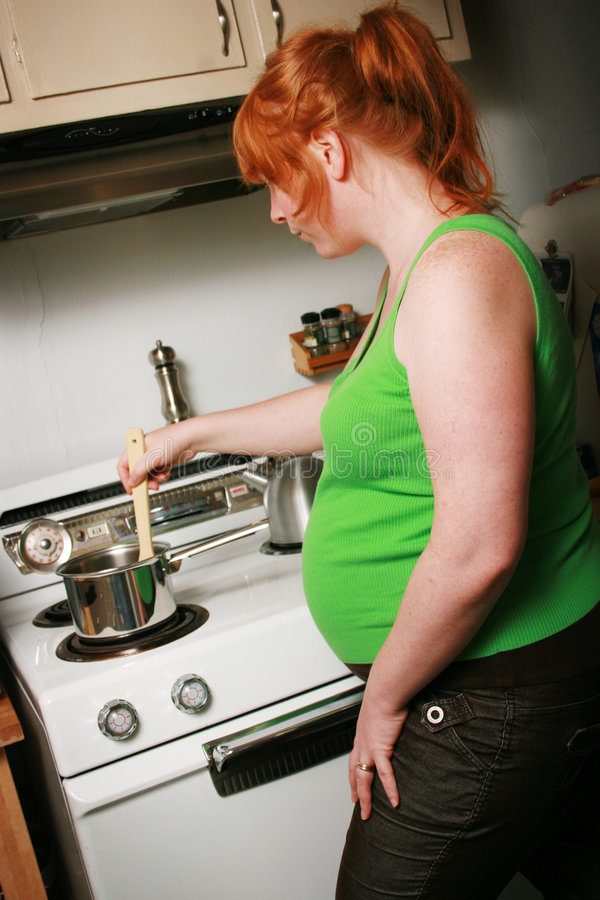 Download Pregnant Woman Cooking Royalty Free Stock Photos - Image: 3606338