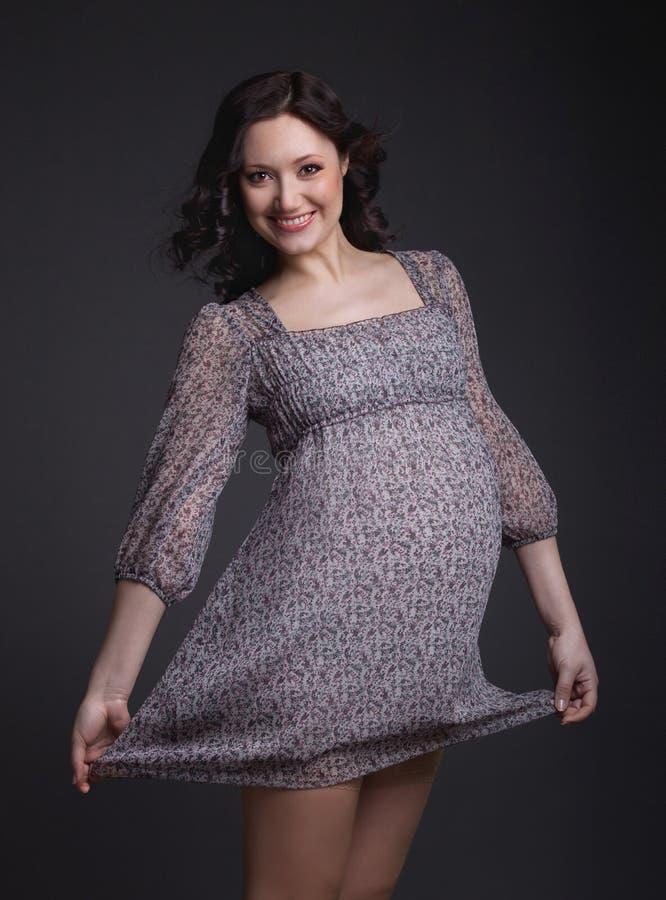 Pregnant woman on dark background stock photo