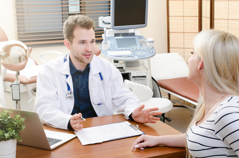Pregnant woman in doctor`s office. Pregnant women in doctor`s office. doctor pregnant women specialist desk office showing ultrasound concept stock image