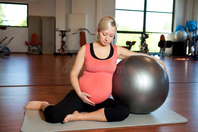 Pregnant Woman Doing Relaxation Exercise Royalty Free Stock Photos