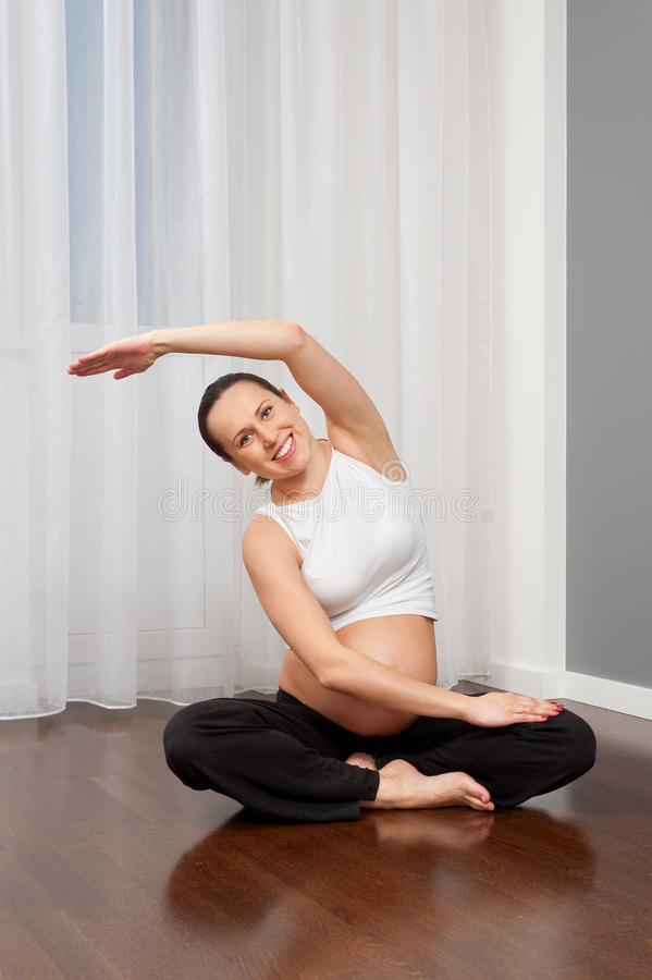 Download Pregnant Woman Doing Yoga At Home Stock Photo - Image: 23502044
