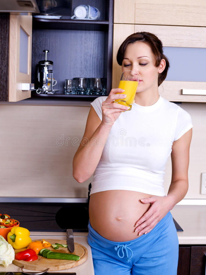 Download Pregnant Woman   Drinks The Orange Juice Stock Photo - Image: 12488584