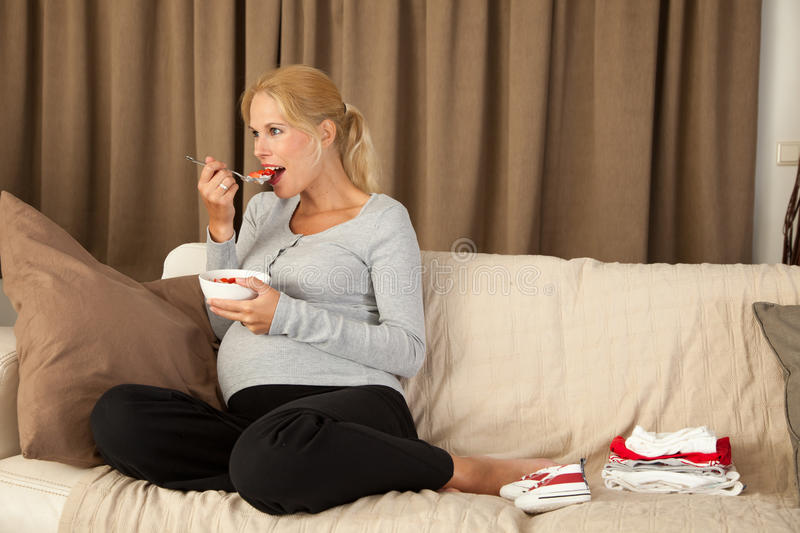 Pregnant woman eating a healthy lunch royalty free stock photography