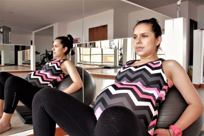 Pregnant woman exercise with a ball stock photos