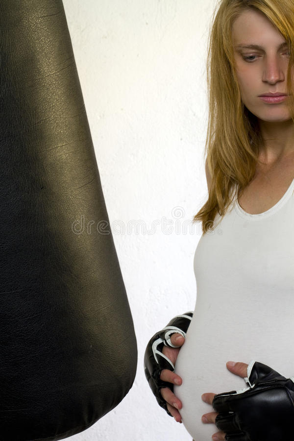 Pregnant woman exercising stock images