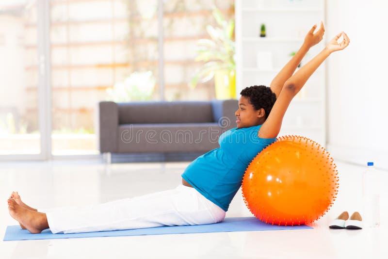 Pregnant woman exercising royalty free stock image