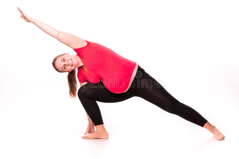 Pregnant woman exercising isolated on white stock image
