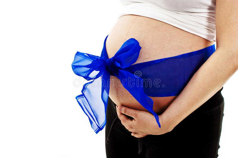 Pregnant woman expecting a baby boy. Isolated on white royalty free stock images