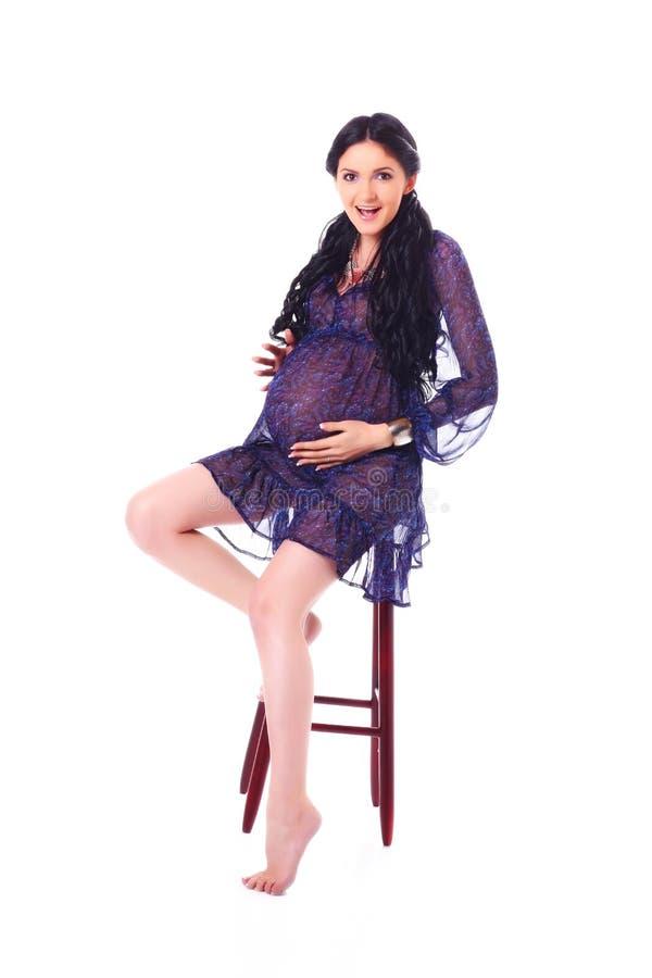 Pregnant woman feeling baby moves royalty free stock photos