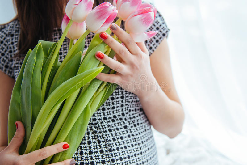 Pregnant woman with flowers royalty free stock photography
