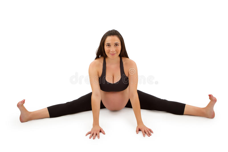 Pregnant woman in forward fold yoga pose
