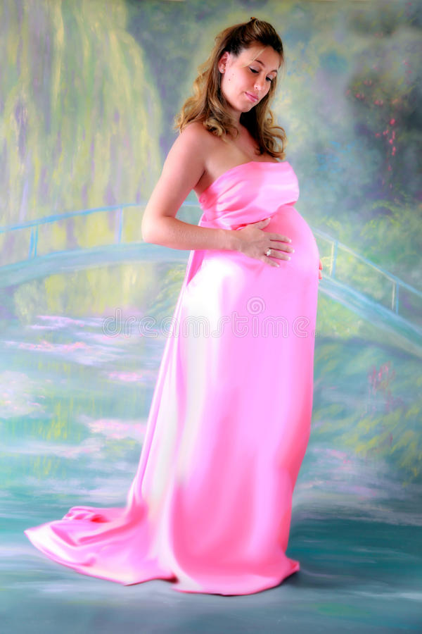 Pregnant woman in gown royalty free stock image