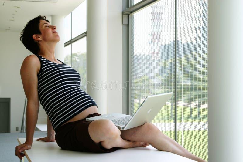 Pregnant woman having breaktime stock photography