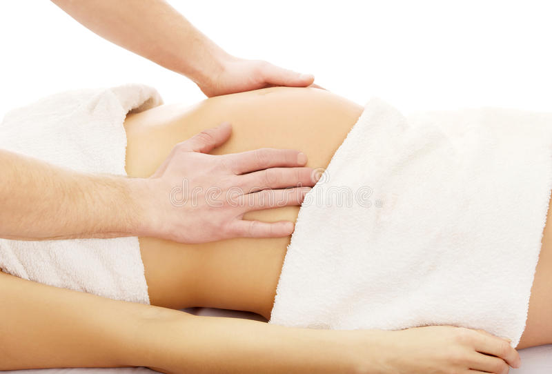 Pregnant woman having a relaxing massage royalty free stock photos