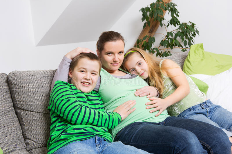 Pregnant woman with her children royalty free stock photo