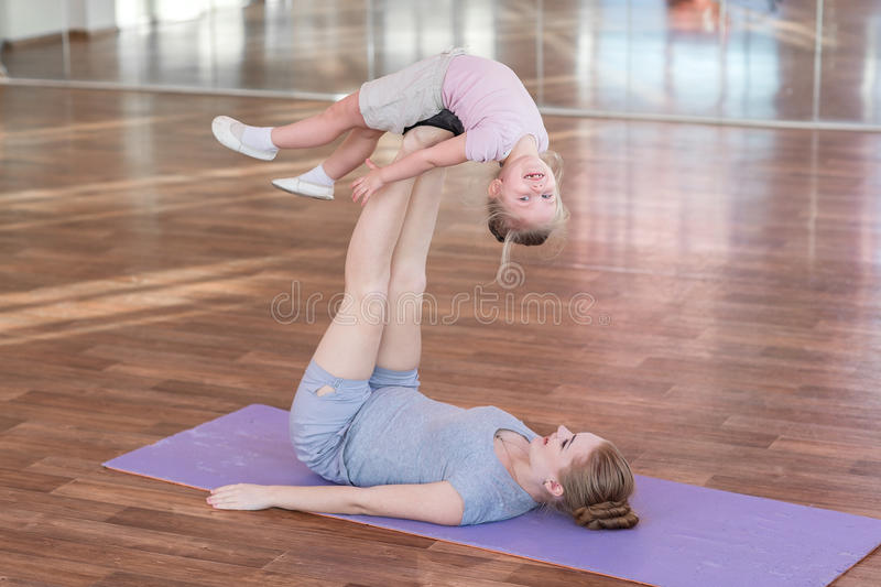 Pregnant Woman With Her Daughter Doing Gymnastics Stock ...