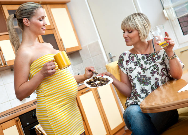 Pregnant woman with her sister stock photo