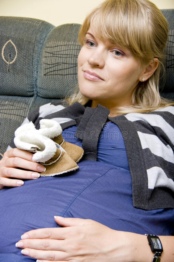 Download Pregnant Woman Hold Baby Shoes Stock Image - Image: 10414397
