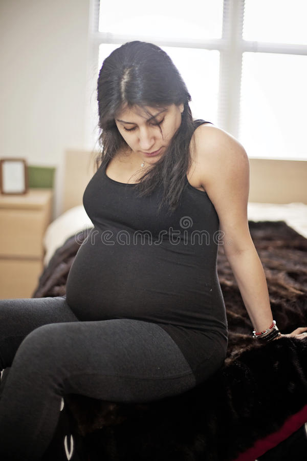 Pregnant woman at home royalty free stock photos