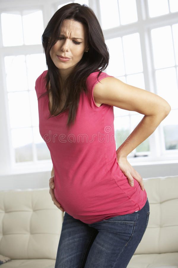 Pregnant Woman At Home With Backache royalty free stock photos