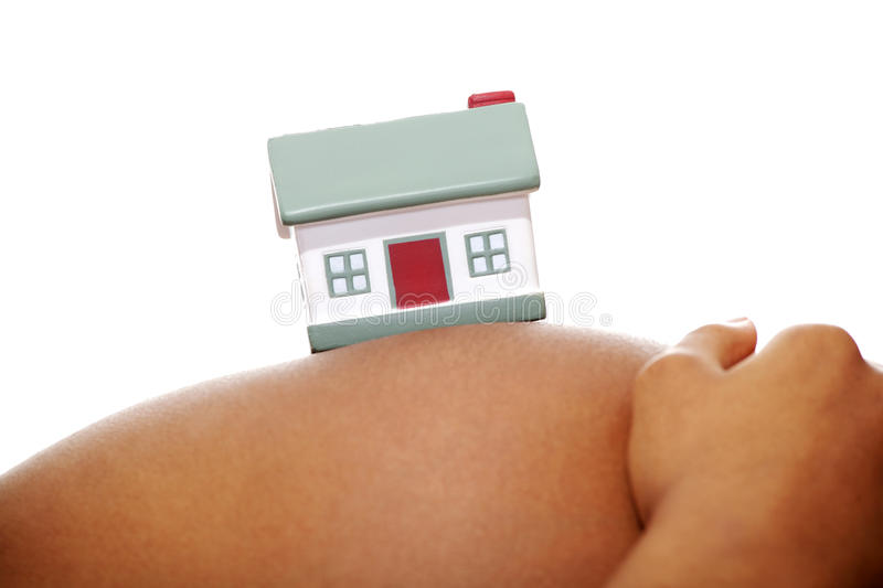 Pregnant woman with house toy stock photo