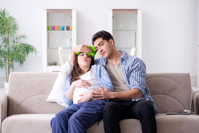 The pregnant woman with husband at home royalty free stock photos