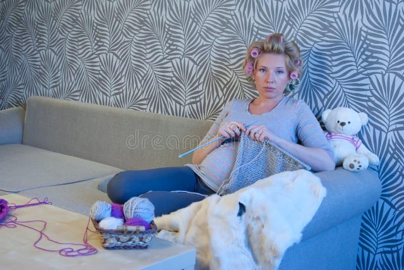Pregnant woman knitting royalty free stock photos