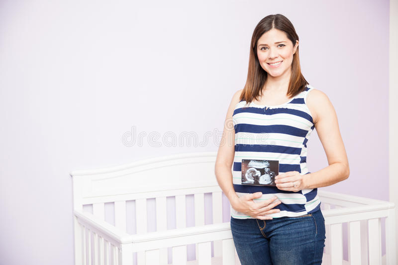Pregnant woman loving her ultrasound stock image