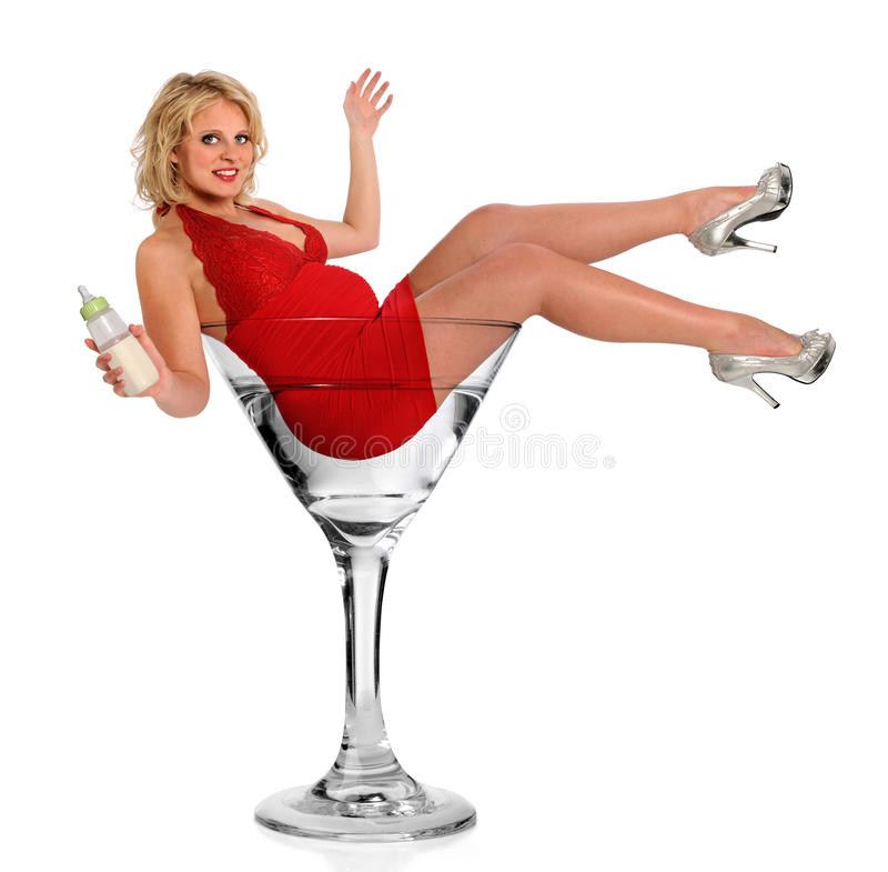 Pregnant Woman In Martini Glass. Pregnant woman holding baby bottle in martini glass isolated over white background stock images