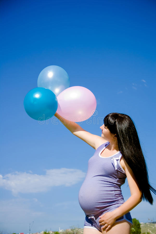 Download Pregnant Woman On A Meadow With Blue Sky Royalty Free Stock Photo - Image: 25962585