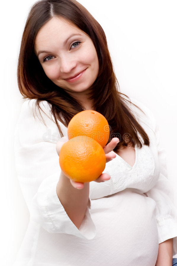 Download Pregnant woman and oranges stock image. Image of beautiful - 8467427