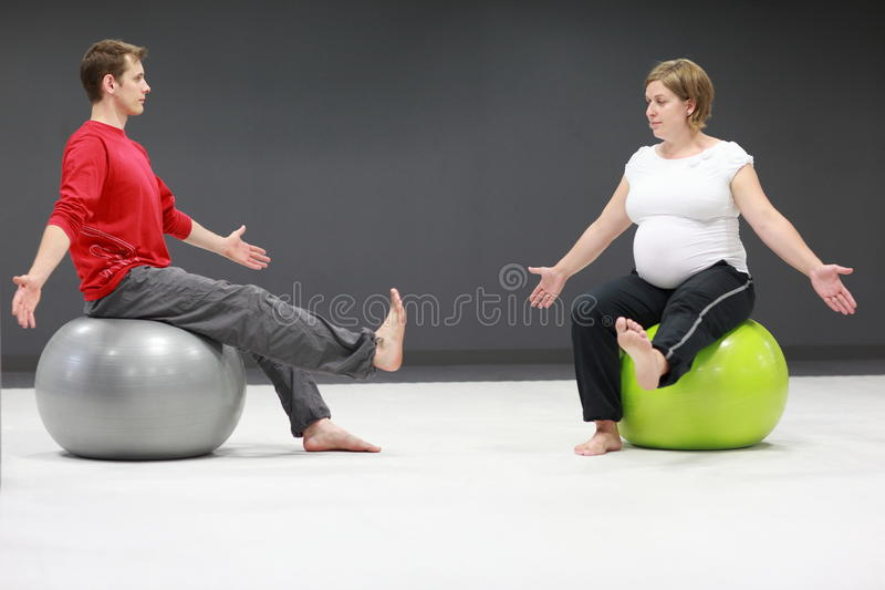Pregnant woman + personal trainer royalty free stock images