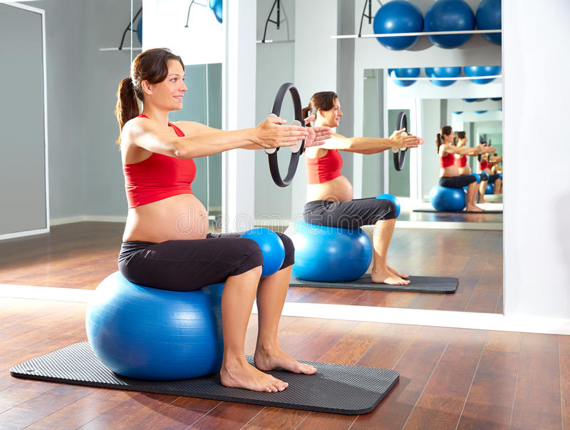 Pregnant woman pilates exercise magic ring stock photo