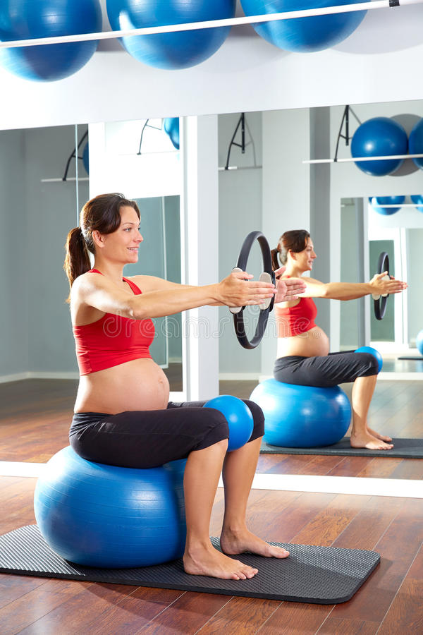 Pregnant woman pilates exercise magic ring royalty free stock images