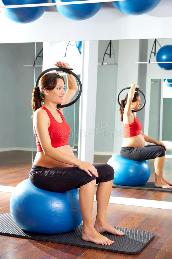 Pregnant woman pilates exercise magic ring royalty free stock photography