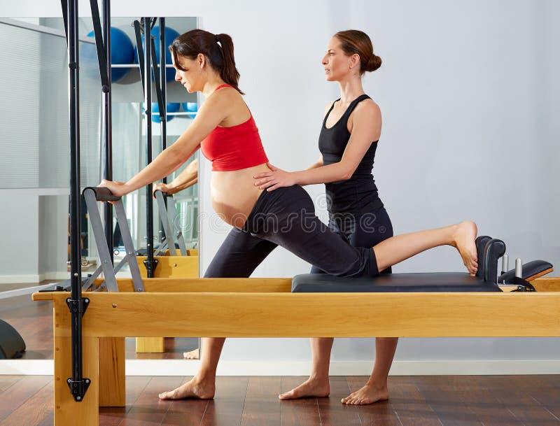 Pregnant woman pilates reformer cadillac exercise stock photo