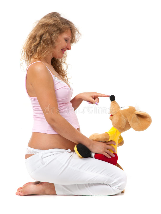 Pregnant woman is playing with a toy stock images