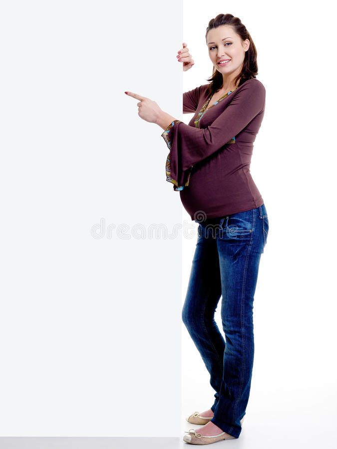 Pregnant Woman Points On The  Advertisement Banner Royalty Free Stock Images