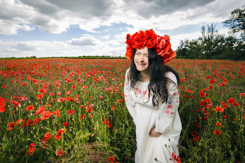 Pregnant woman on poppy field stock photography